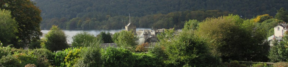 View over Bowness rooftops to Lake Windermere from Ellen Brow